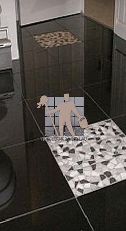 granite tile floor in bathroom black with one white tile brisbane